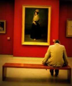 A man sits alone at the Louvre. Was he overly moved by the art?