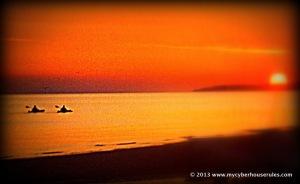 Kayak under a sunset