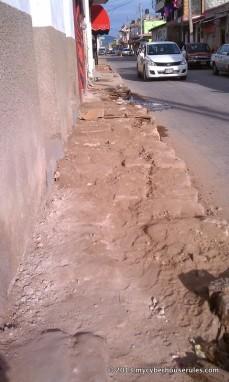 The textures of this sidewalk: bare minimum