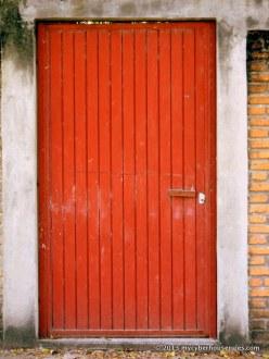 Red door: vertical stripes against the bricks horizontal lines