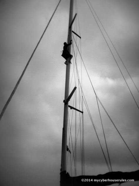 Climbing up the mast at anchorage